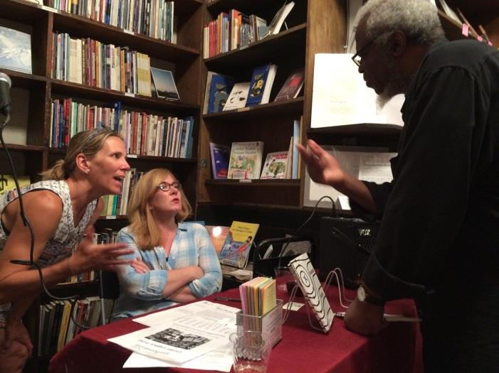 Christine Jones, Erin Belieu, and Grolier Poetry Bookshop's owner, Ifeanyi Menkiti, engaging in poetry conversation. Photo by Michael Jones